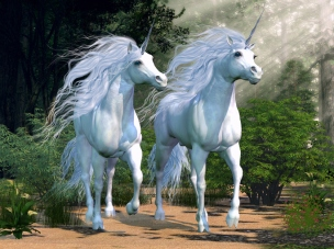 Two majestic unicorns in an enchanted forest